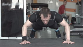 Fitness man doing clapping push-ups exercise intense training in gym. stock video