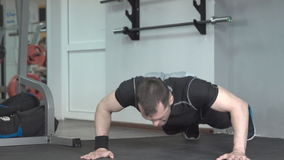 Fitness man doing clapping push-ups exercise intense training in gym. stock footage