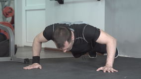 Fitness man doing clapping push-ups exercise intense training in gym. stock video footage