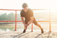 Fitness man doing clapping push-ups exercise intense training outdoors. Fitness man doing clapping push-ups exercise intense training outdoors royalty free stock image