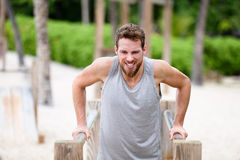 Fitness man doing dips at outdoor gym workout Royalty Free Stock Photography