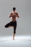 Fitness man doing exercise on one leg Stock Photo