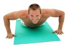 Fitness man doing exercises Stock Photos