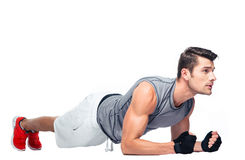 Fitness man doing exercises on the floor Stock Image