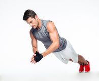 Fitness man doing exercises on the floor Stock Images