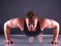 Fitness man doing push ups on floor Royalty Free Stock Photo