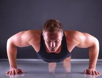 Fitness man doing push ups on floor Royalty Free Stock Photo