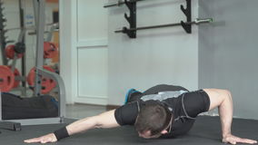 Fitness man doing push-ups in gym. Male doing exercise on the upper part chest of the body. stock video