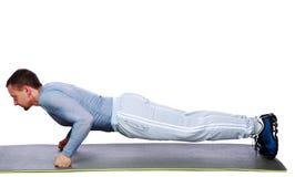 Fitness man doing push ups on mat Stock Photo