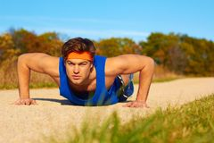 Fitness man doing push ups Stock Photo
