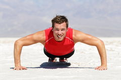 Fitness man doing push ups training outdoor Stock Photos