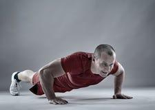 Fitness man doing pushups Stock Photo