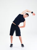 Fitness man doing stretching exercises Stock Photo