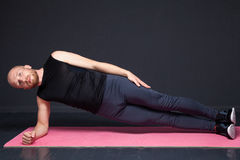Fitness man doing stretching exercises royalty free stock images