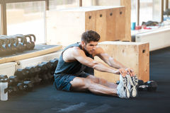 Fitness man doing stretching. In gym royalty free stock image
