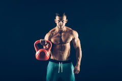 Fitness man doing a weight training by lifting Royalty Free Stock Image