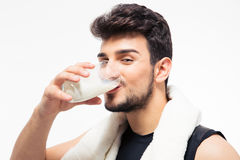Fitness man drinking milk Royalty Free Stock Images