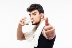Fitness man drinking milk Stock Photos