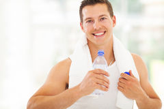 Fitness man drinking water Stock Images
