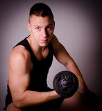 Fitness man with dumbbell. Royalty Free Stock Photos