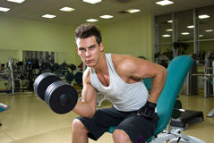 Fitness - man with dumbbells Stock Photo
