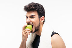 Fitness man eating apple Royalty Free Stock Photos