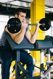 Fitness man exercising with barbell in gym. Fitness man dead lift. Sports and fitness - concept of healthy lifestyle. Royalty Free Stock Image