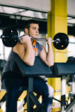 Fitness man exercising with barbell in gym. Fitness man dead lift. Sports and fitness - concept of healthy lifestyle. Royalty Free Stock Photos