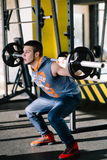 Fitness man exercising with barbell in gym. Fitness man dead lift. Sports and fitness - concept of healthy lifestyle. Royalty Free Stock Photography