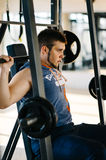 Fitness man exercising with barbell in gym. Fitness man dead lift. Sports and fitness - concept of healthy lifestyle. Royalty Free Stock Images