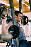 Fitness man exercising with barbell in gym. Fitness man dead lift. Sports and fitness - concept of healthy lifestyle. Royalty Free Stock Photo