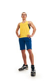 Fitness man. full length. shot from down. Portrait of a athletic man. full length over a white background royalty free stock image