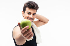 Fitness man holding apple Stock Photos