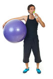 Fitness man holding ball and drink water Stock Photos