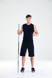 Fitness man holding barbell and showing thumb up Royalty Free Stock Image