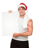 Fitness man holding sign in christmas santa hat stock images