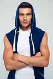 Fitness man in hood standing with arms folded Royalty Free Stock Photos