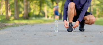 Fitness man legs walking in the park outdoor, male runner running on the road outside, asian athlete jogging and exercise on footp. Young fitness man legs stock images