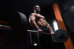 Fitness man lifting weight royalty free stock photo