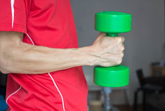 Fitness Man Lifting Weights. Green Dumbell Stock Image