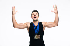 Fitness man with medals celebrating his success Royalty Free Stock Image