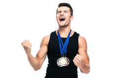 Fitness man with medals celebrating his success Royalty Free Stock Photos