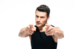 Fitness man pointing fingers at camera Stock Photos
