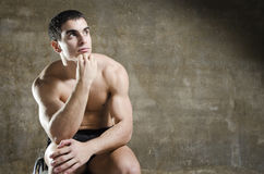 Fitness man posing with naked torso Royalty Free Stock Images