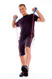Fitness man posing with stretching rope Stock Photography
