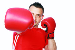 Fitness man punching with red boxing gloves Stock Photography