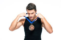 Fitness man puts on his medal Royalty Free Stock Image