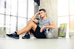 Fitness man resting at gym Stock Images
