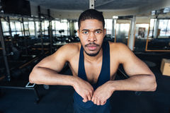 Fitness man resting in the gym after workout Royalty Free Stock Images
