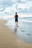 Fitness Man Running On Beach. Runner Jogging During Outdoor Workout Stock Images